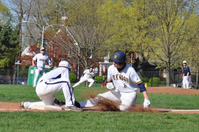Grant Kincaid (12) slides into third base during the game.  The Jacks fought hard and won the victory by one point after losing to Monroe the previous game.
