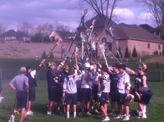 The Lacrosse team ends practice at Old River with a team huddle.