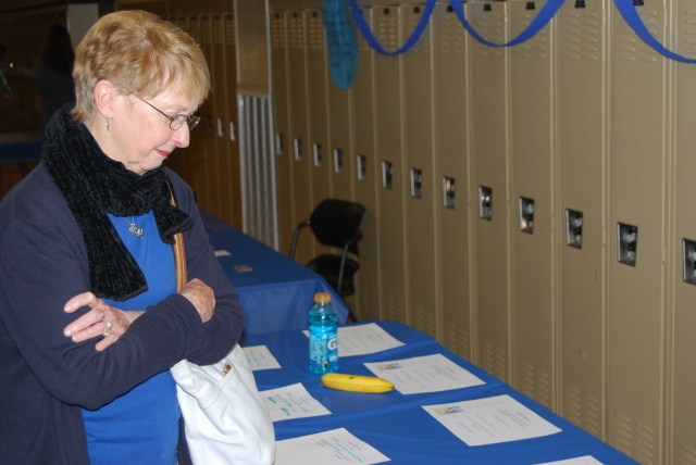 A woman peruses the offers at the silent auction. Patrons of all ages attended the benefit, including grandparents of students and little siblings whose family members performed in the concert.