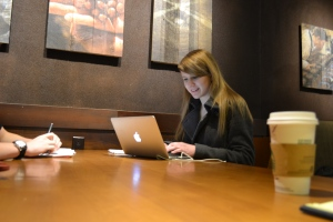 """Emmaline Bennet (11),  resident white girl, works on her homework at Starbucks. Some students  frown upon white girl jokes. """"I think they could hurt someone's feelings,"""" Paige Morris (12) said."""