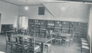 Long Gone Library: Before the current library was added to the building, the library was in what is now Mr. Lane's room on the third floor. There is still the fireplace in his room from the old library. Today, the doors have been moved and walls have been added. Photo Contributed By Acorn