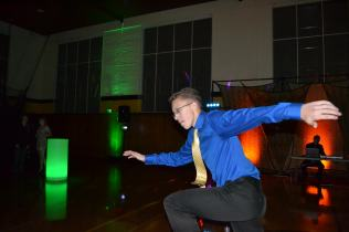 "Cameron Alt (10) took to the dancefloor at homecoming to dance to the fast paced music. Student council sent out a survey to homeroom classes to find out what music students wanted to hear. ""[Homecoming] is all about the dancing!"" Alt said. ""The music motivates it all."""