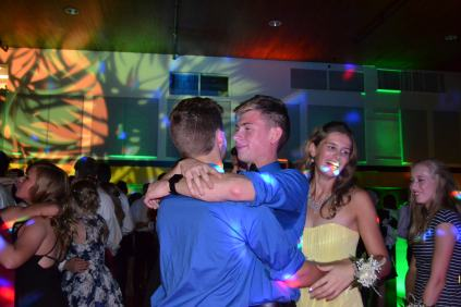 "Max Williams (12) and his homecoming date, Logan Johnson (12) calmed their dance moves to enjoy a slower song together. ""Homecoming can get pretty fast paced,"" Williams said. ""It's like: drink, dance, repeat."""