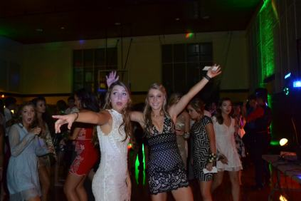 "Juniors Milly Prout and Caroline Winch danced through the night to the fast paced music that played at homecoming. Winch continued to dance despite a recent soccer injury. ""[The injury] didn't affect my dance moves,"" Winch said. ""I honestly think I danced even better than I would have without it."""