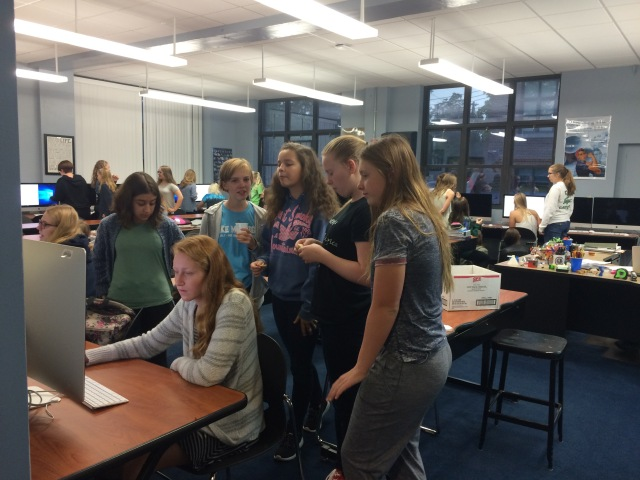 "On Wednesday Oct. 12, junior high and high school girls ate a provided breakfast at a Femineering meeting. The girls meet every other Wednesday at 7:30 a.m. in the engineering room. Led by Tony Rainsberger the club boasts about 25 to 30 girls. ""Femineering is a bunch of girls who like science and get together to do science related activities,"" Amelia Kvalheim (12), a member of Femineering explained. ""The majority of the STEM fields right now are really aimed towards guys, I think it's important to give girls the opportunity to explore the science world to see if they like it and want to make a career out of it."" Photo By: Lauren O'Connell"