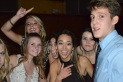 """Juniors Peyton Lauterbach, Caroline Winch, Lily Banke, Ava Millard and Abby Randall, pose with senior Matt Stover. """"You're only in high school for four years so you should take advantage of the time you're given,"""" Millard said."""