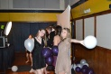 """Juniors Paige Heyl and Caroline Conrath wait in line for the photo booth. """"[Turnabout] was a fun time and I like hanging out with my friends,"""" Heyl said."""